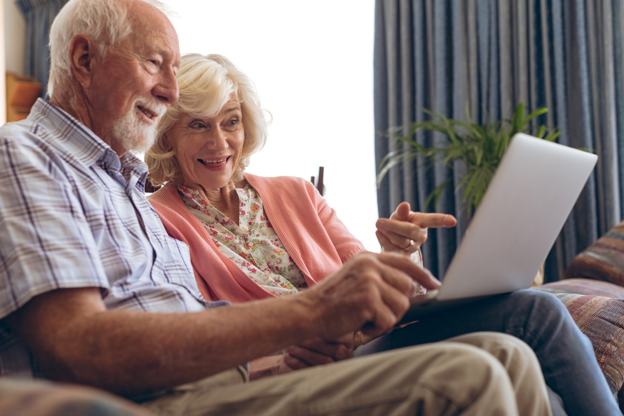 Senior couple using laptop at retirement home